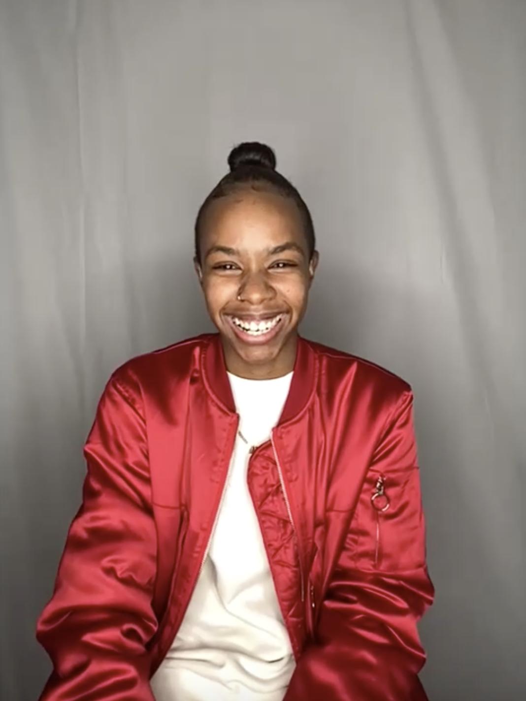Angel smiling wearing a shiny jacket