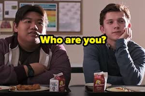 """Ned and Peter Parker are sitting at a lunch table in deep thought with a caption that reads: """"Who are you?"""""""