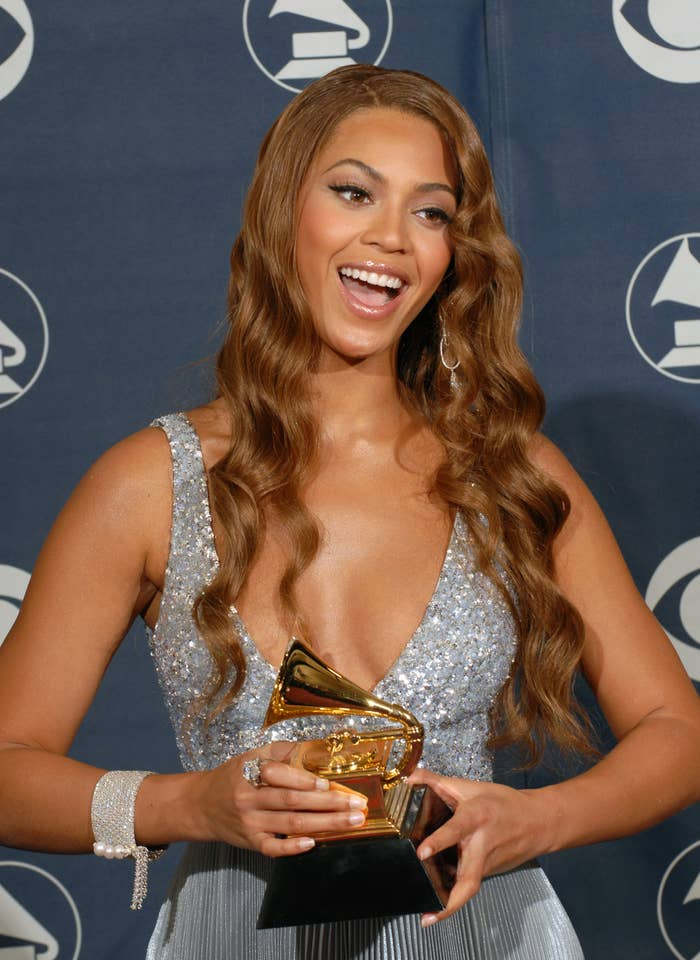 Beyoncé holding a Grammy award