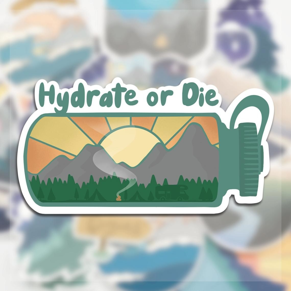 """A sticker that says """"hydrate or die"""" on it above a water bottle that has a sunset over mountains and a forest in it"""