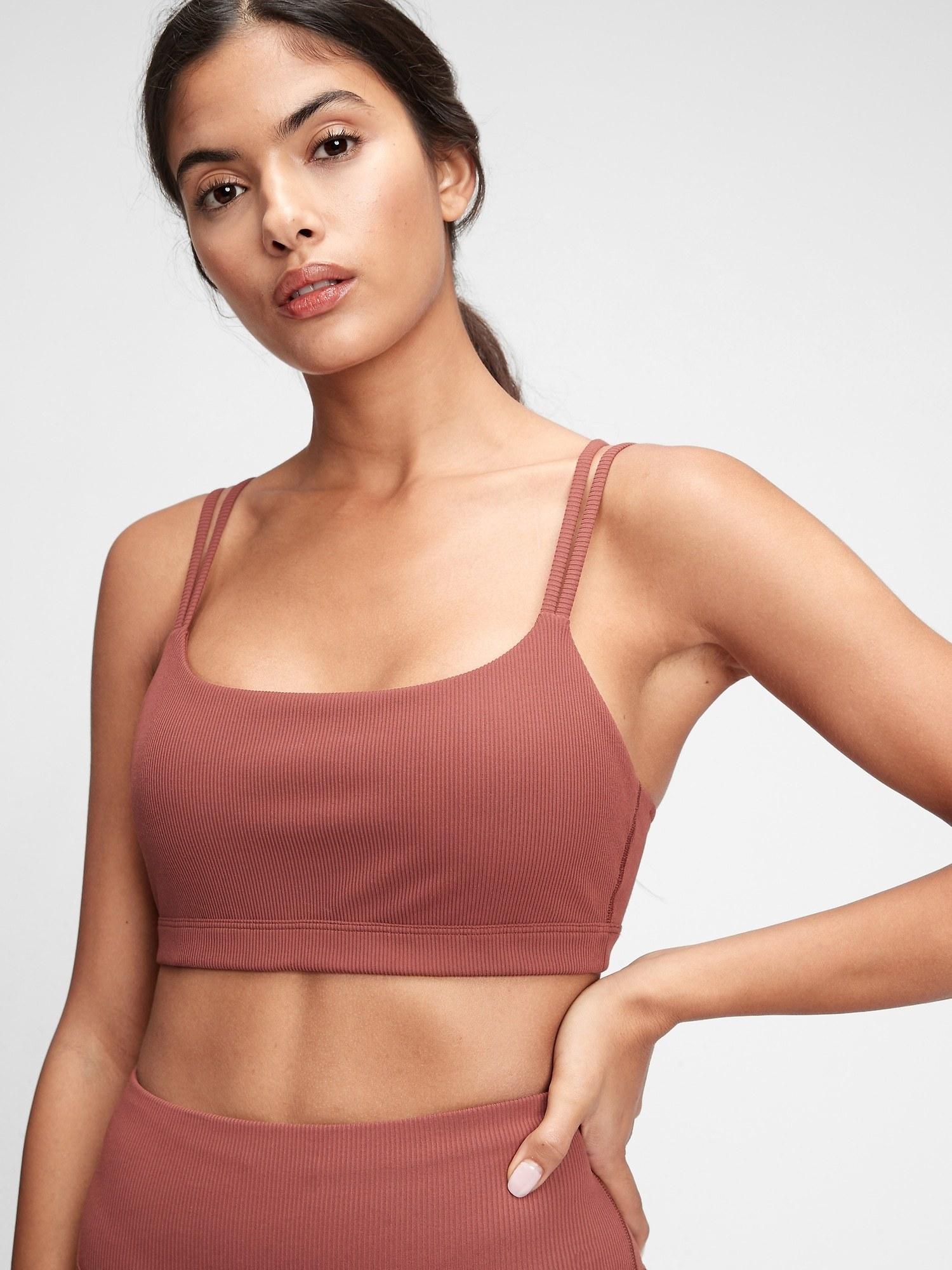 a model wearing the sports bra in pink