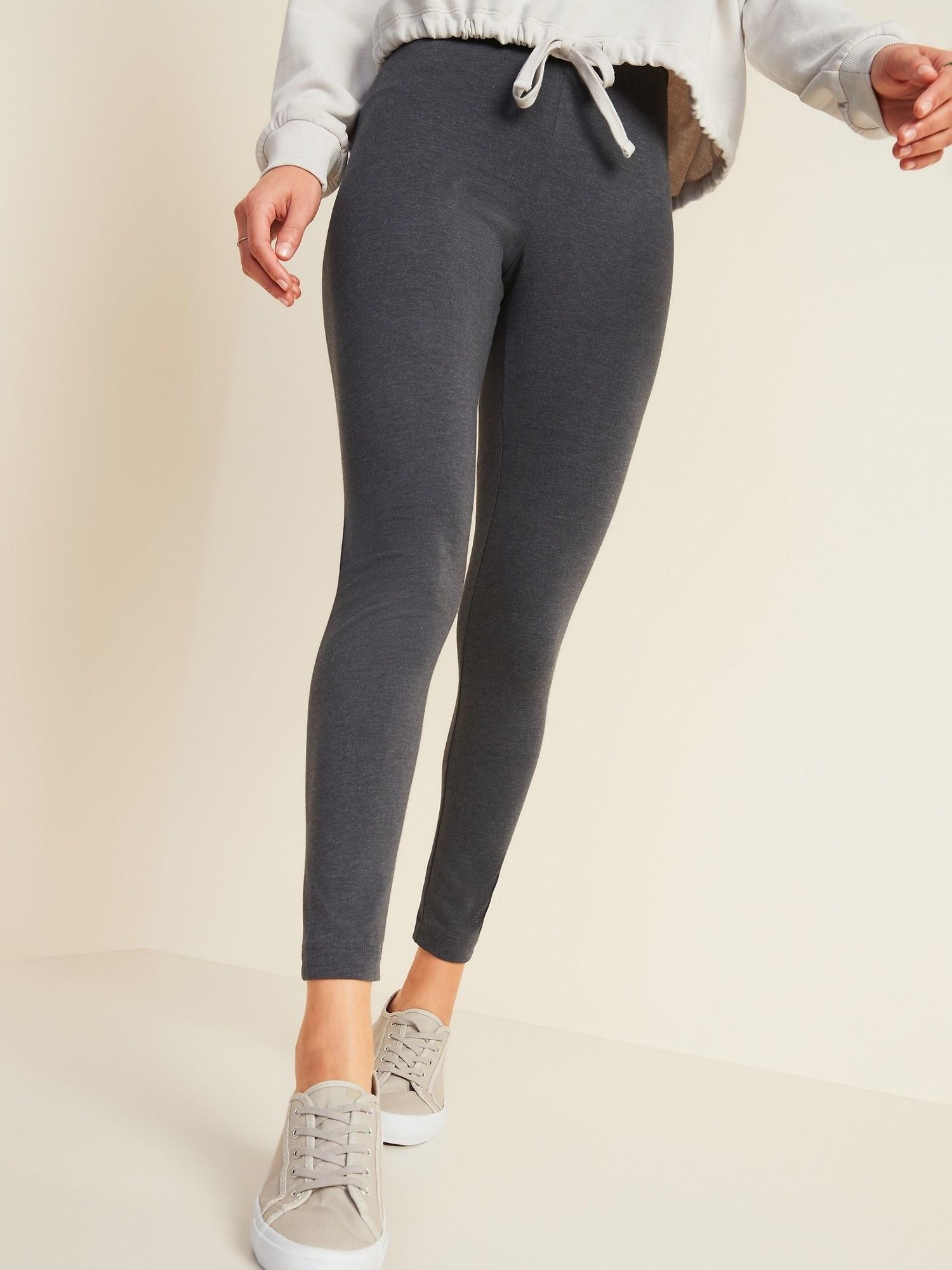 a model in gray leggings
