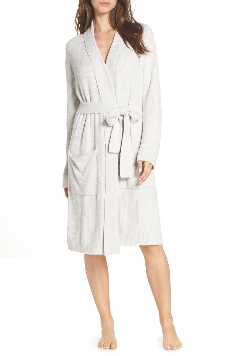 a model in a white plush robe