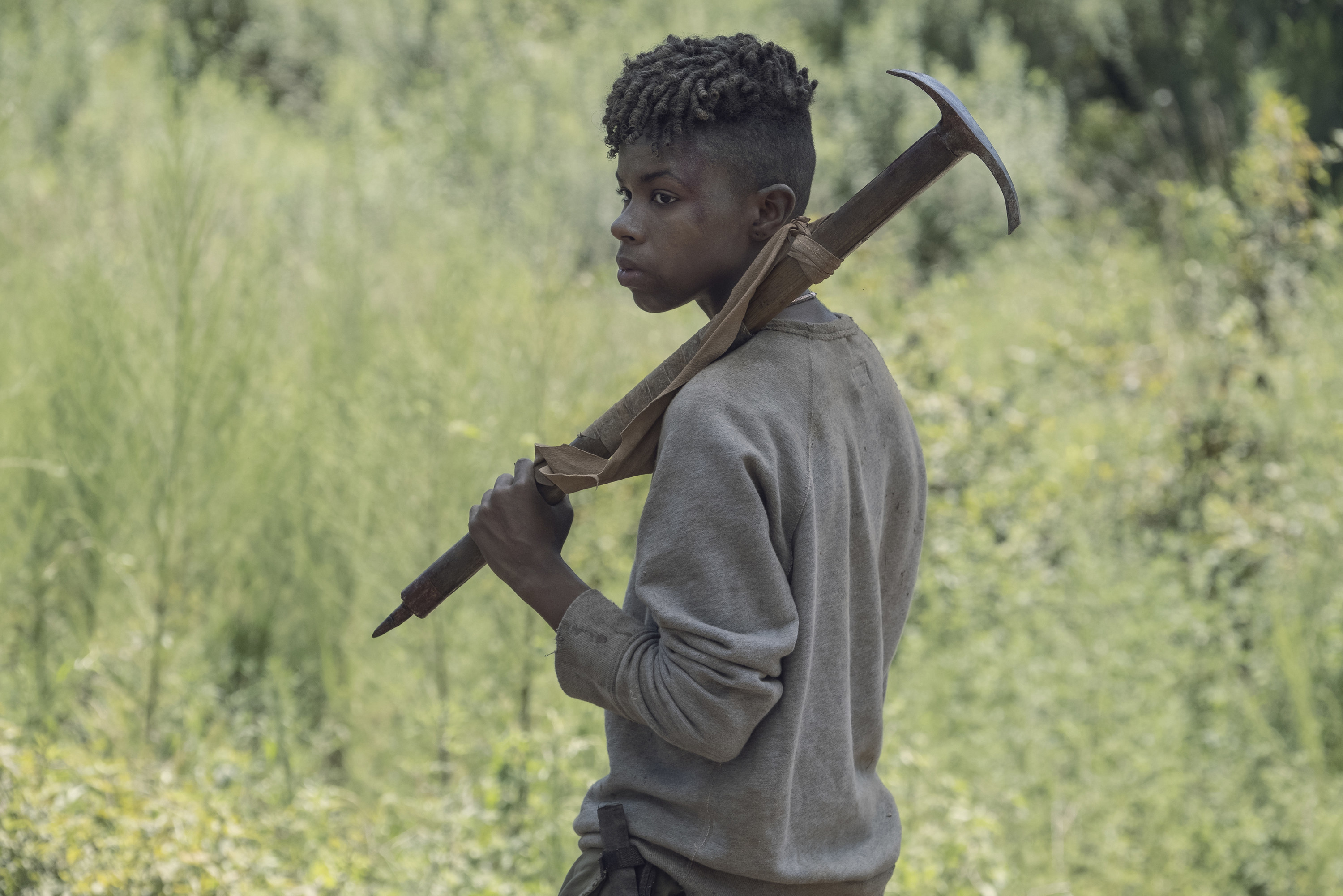 Angel Theory holding a weapon as Kelly on The Walking Dead