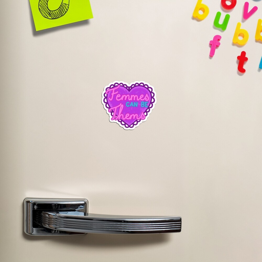 "the ""Femmes can be Thems"" magnet on a purple heart on a fridge"