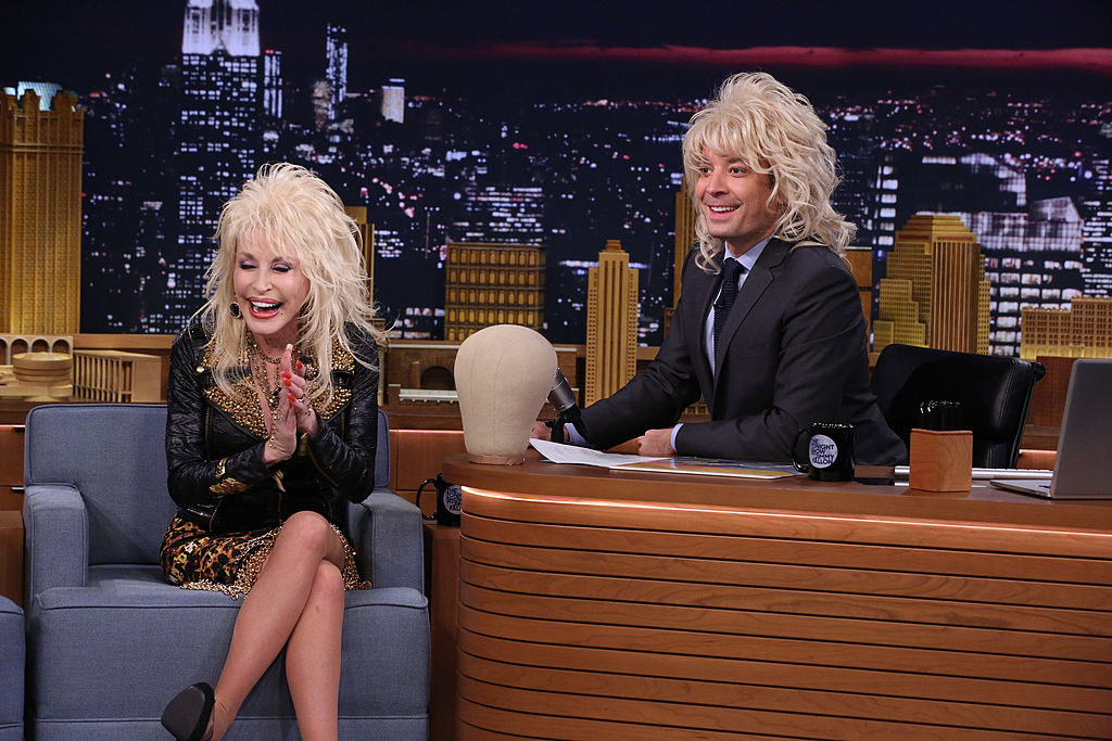 Dolly with Jimmy Fallon, who is wearing her wig