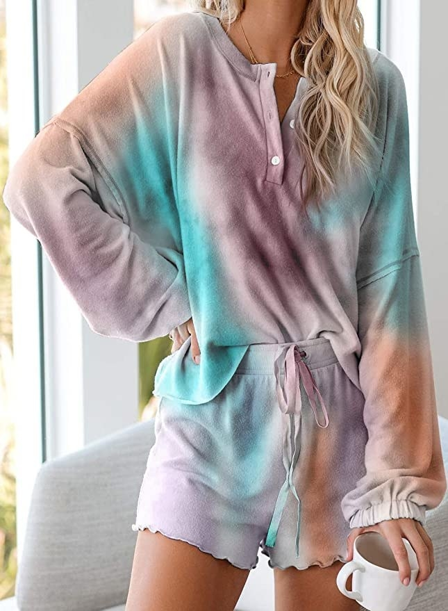 model wearing long sleeve top and matching shorts in a blended tie-dye print