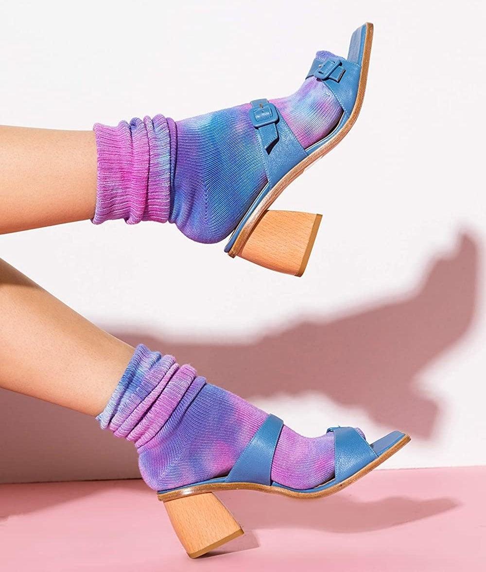 model wearing purple/pink tie-dye socks with heeled sandals