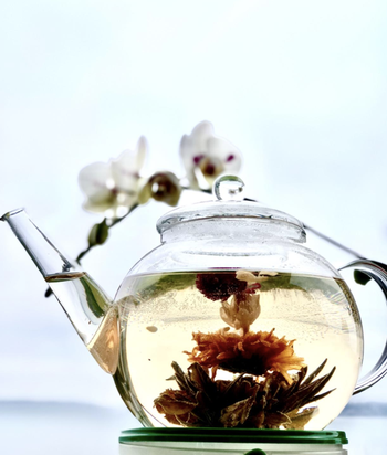 reviewer image of blooming tea blooming in clear glass pot