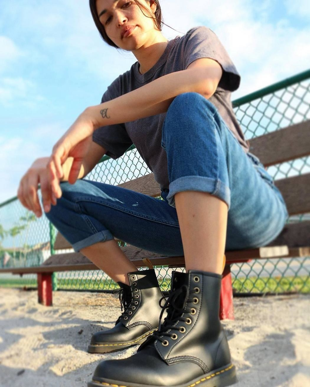 model wearing the thick-soled black combat boots
