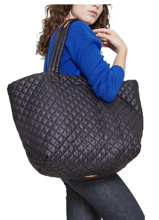 Model wearing black tote bag