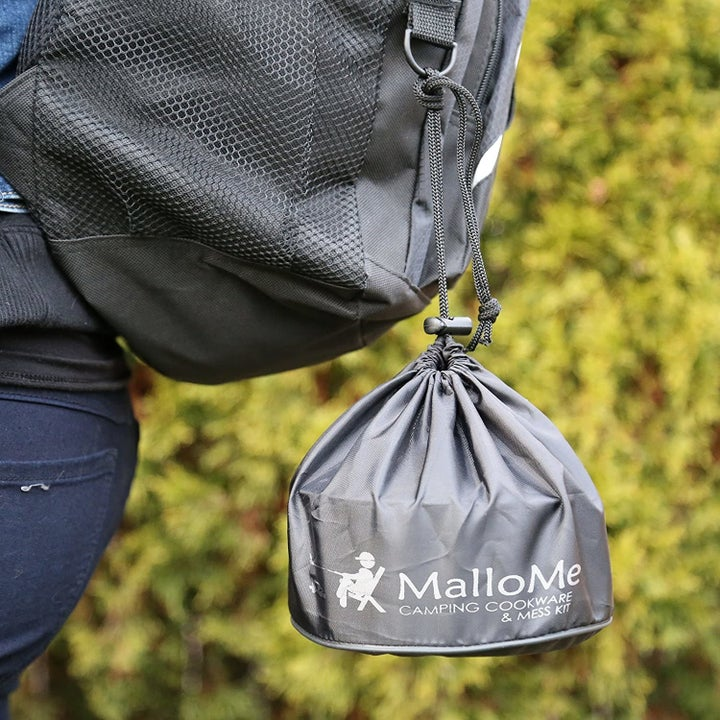 Image showing how the cookware collapses into a compact bag hanging off a hiker's backpack