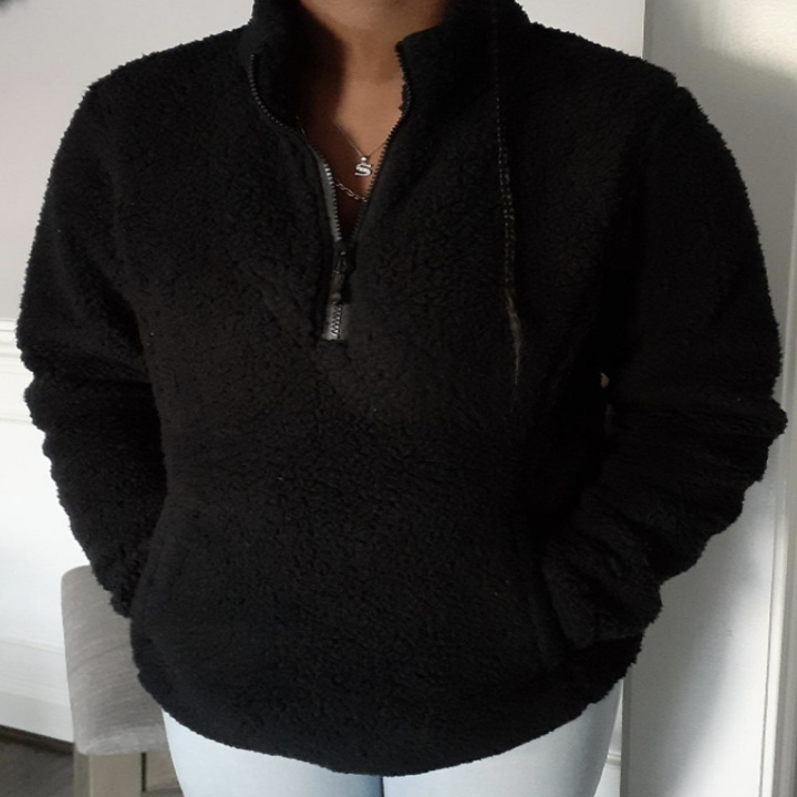 Reviewer wearing black fleece