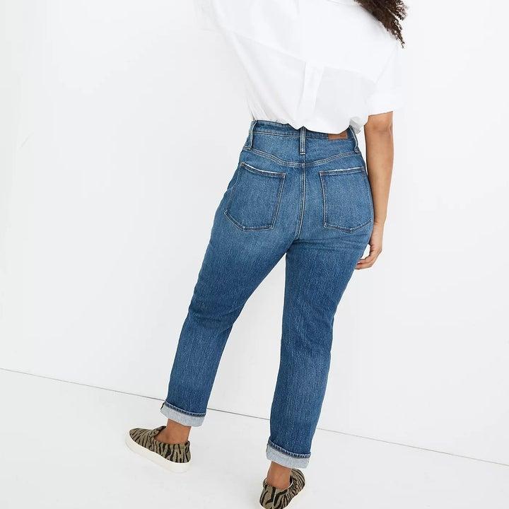 Model wearing blue jeans