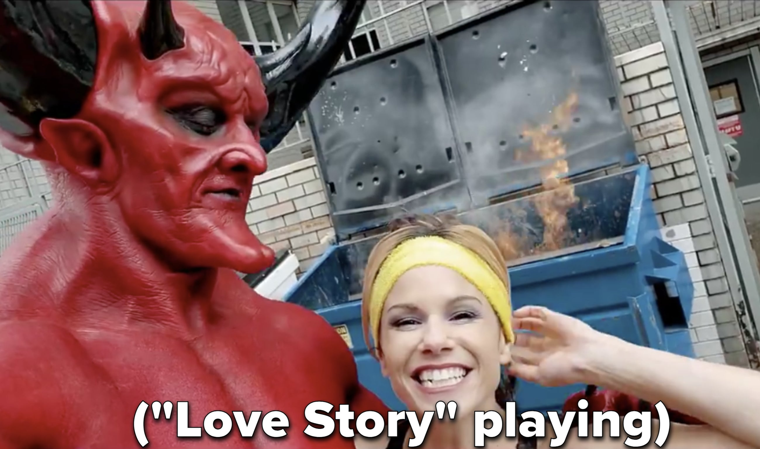 "The Devil and 2020 pose in front of a dumpster fire while ""Love Story"" plays"