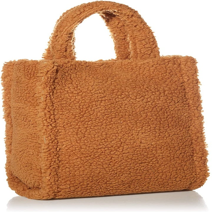 The fluffy brown sherpa tote which has two handles