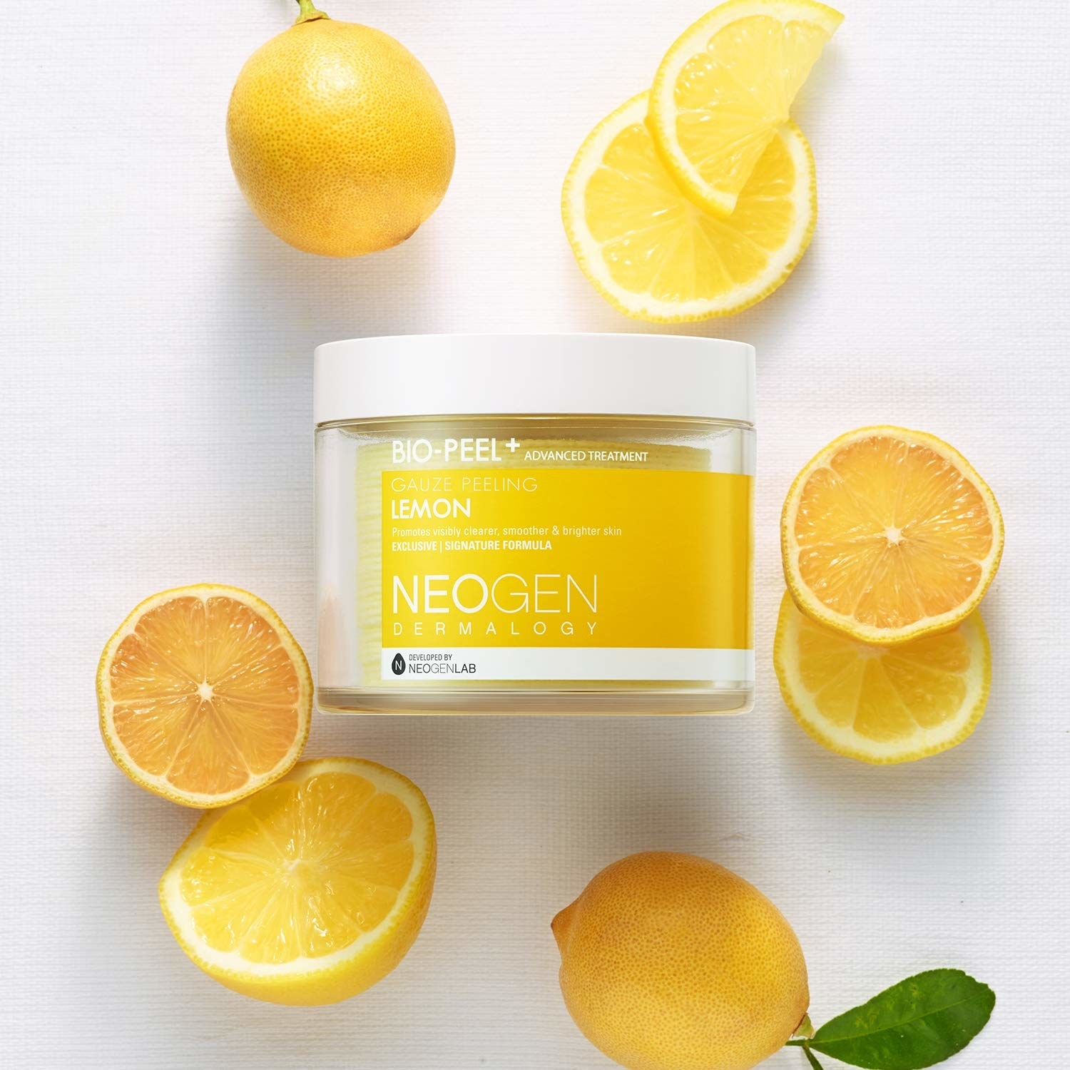 the jar of peeling pads with a twist top and yellow packaging