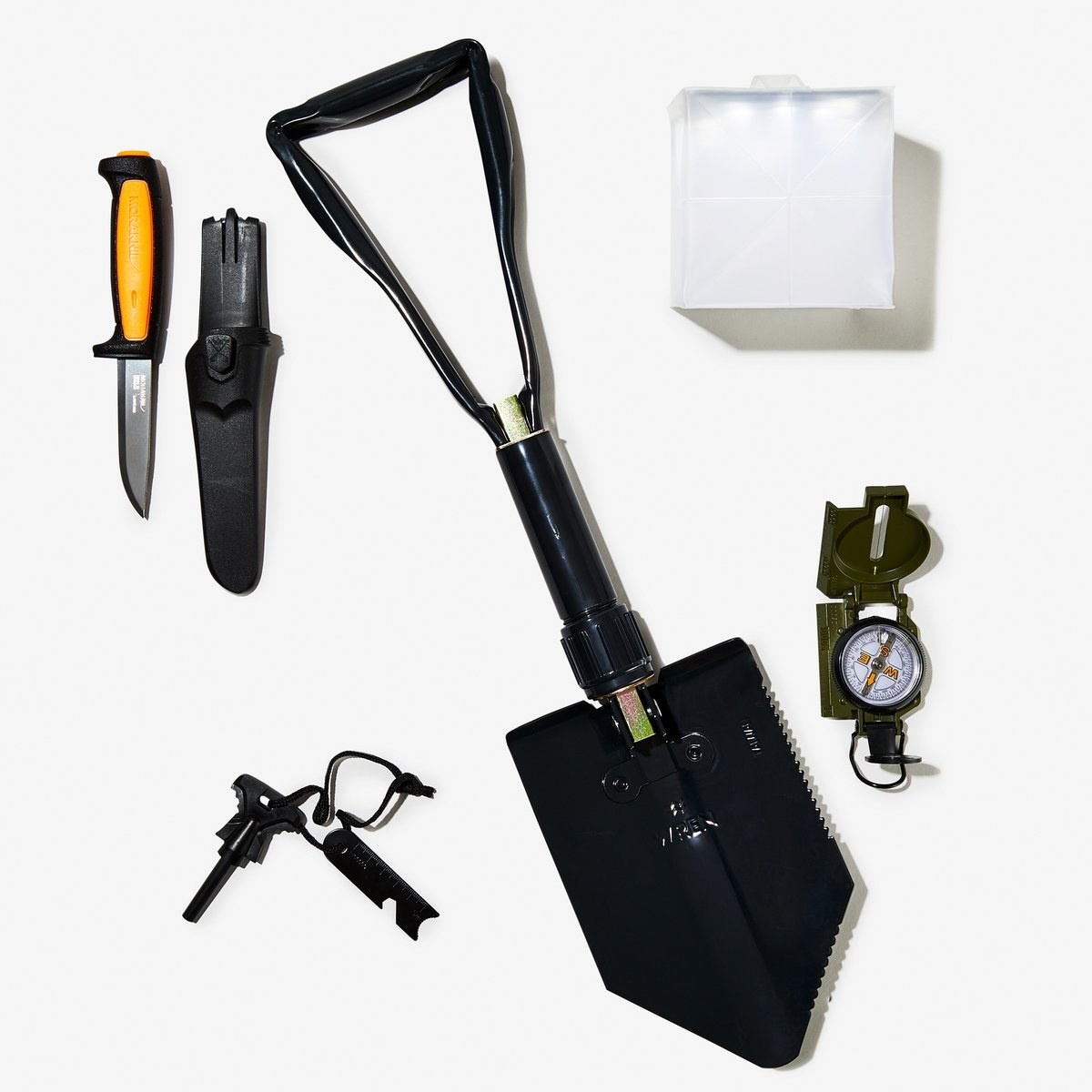 Flatlay image of the kit with the five tools