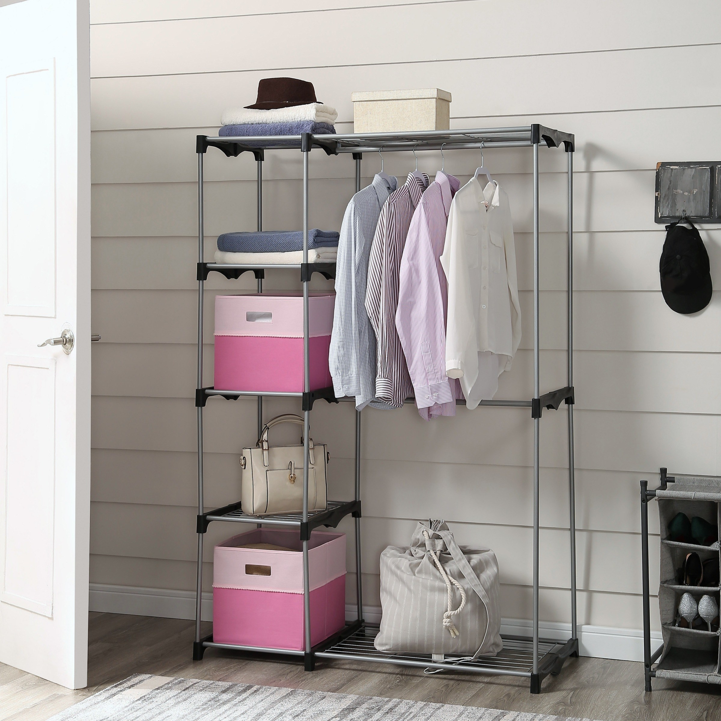 gray garment rack with clothes and accessories organized on it