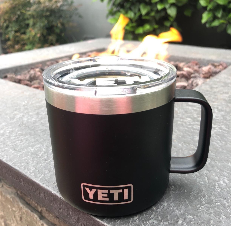 A black Yeti Rambler mug