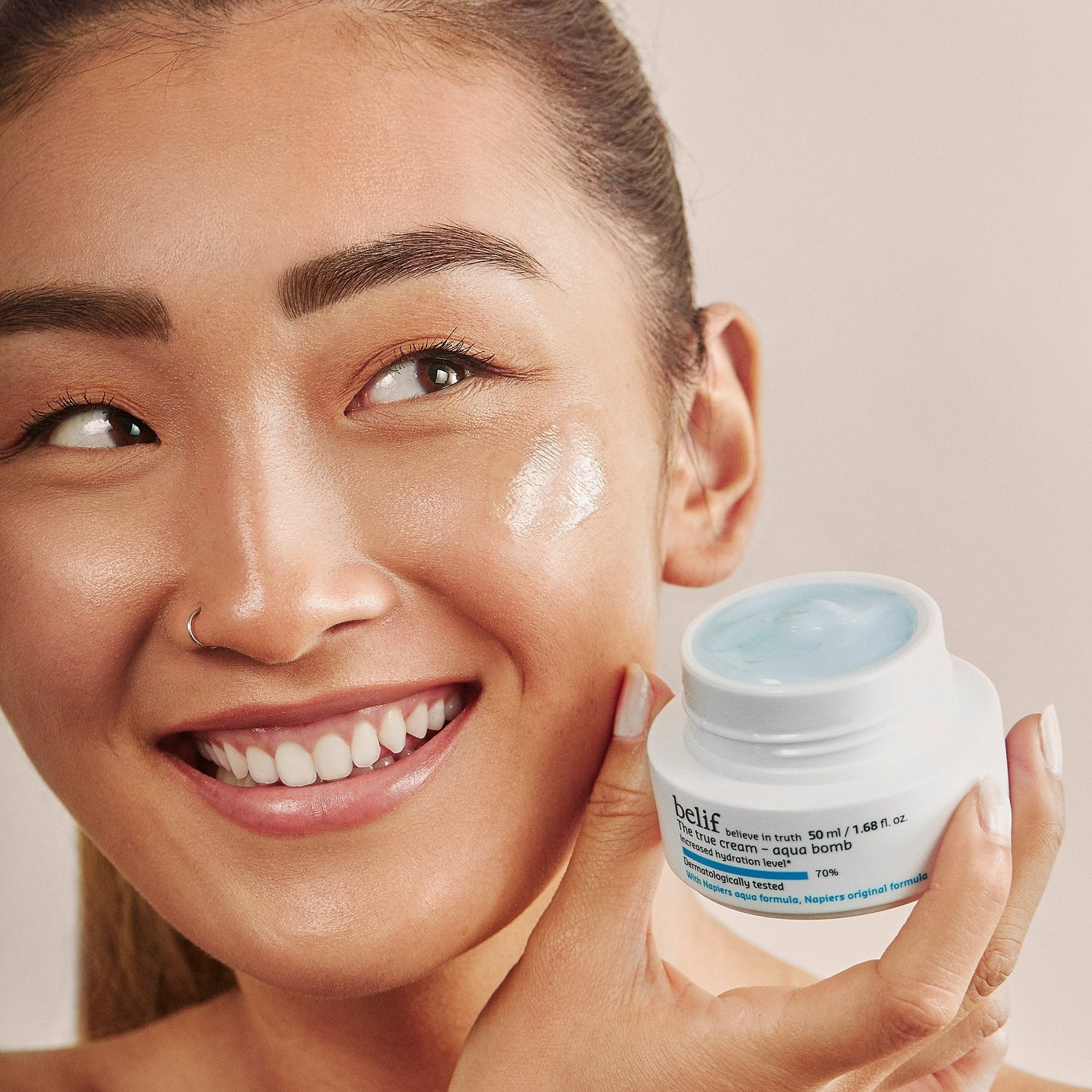 a model holding the cream