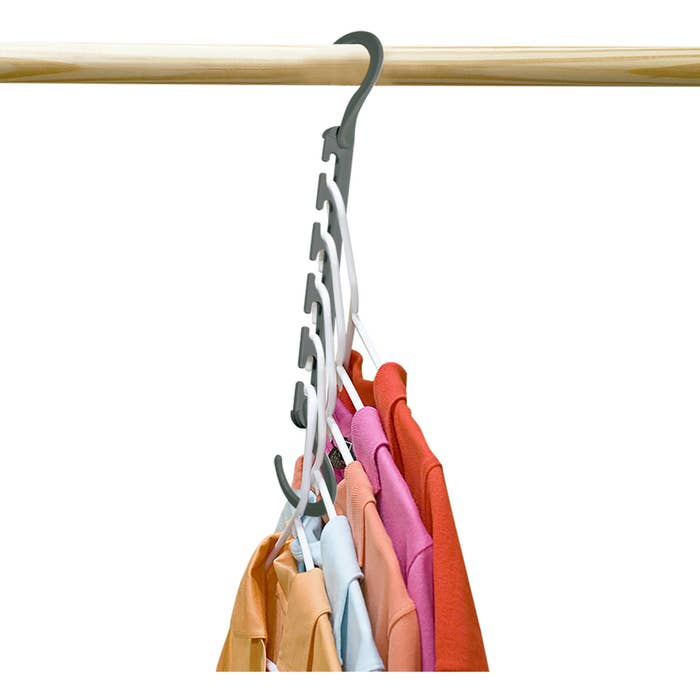 a wonder hanger organizer with five shirts on