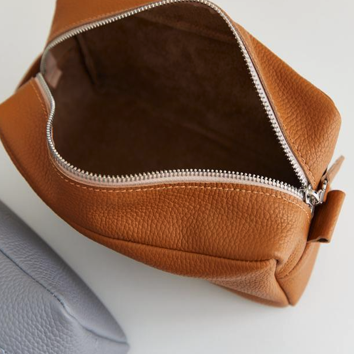 A close-up of a top-down view of a grooming bag, showing how much room is inside