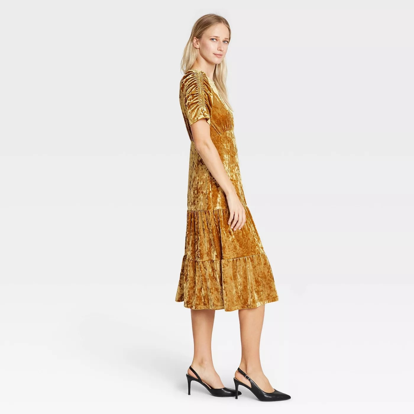 A yellow short sleeve midi dress with a three-tier skirt.