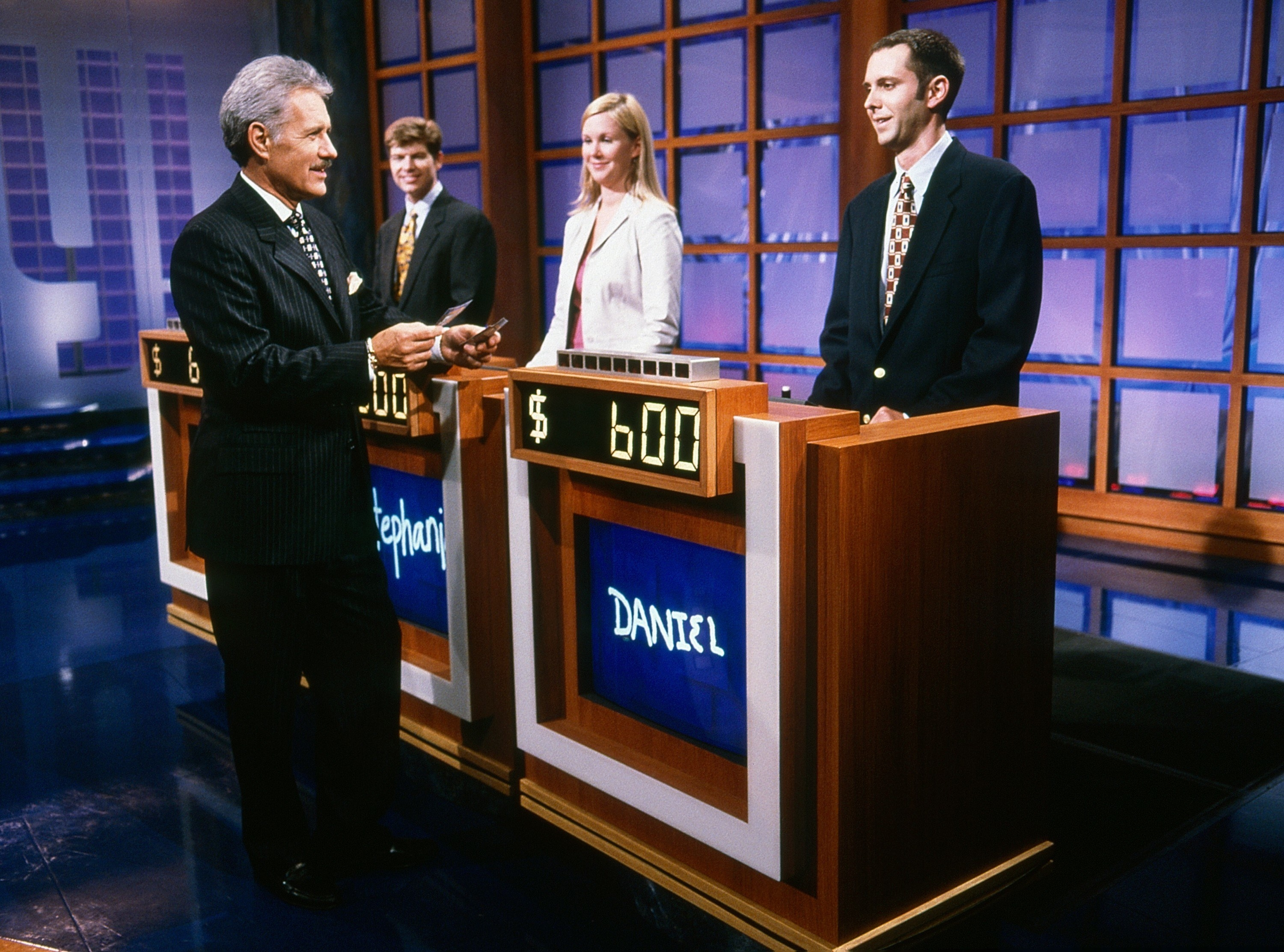 """Alex Trebek with contestants on """"Jeopardy!"""" in 2000"""