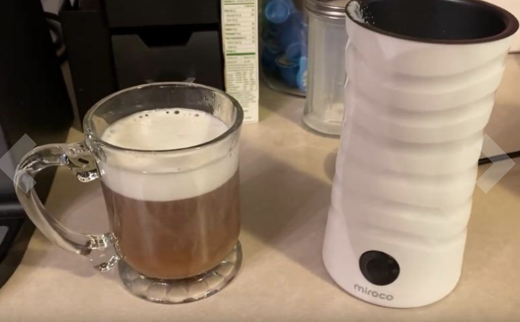 Milk frother with coffee and milk froth