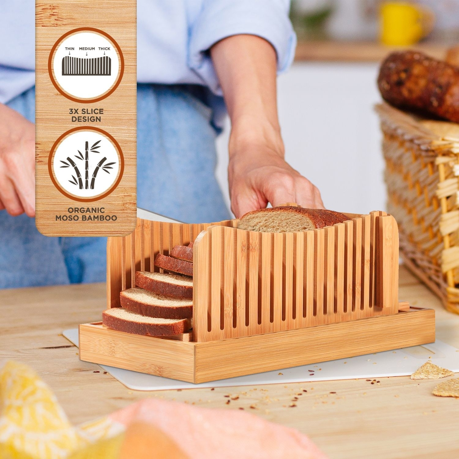 The bread slicer being used to slice bread