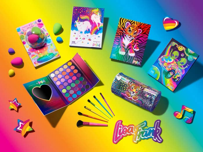 A product shot of the Lisa Frank makeup collection showing three palettes, brushes, and beauty blenders