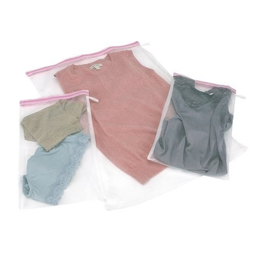 three mesh bags with underwear and shirts in them