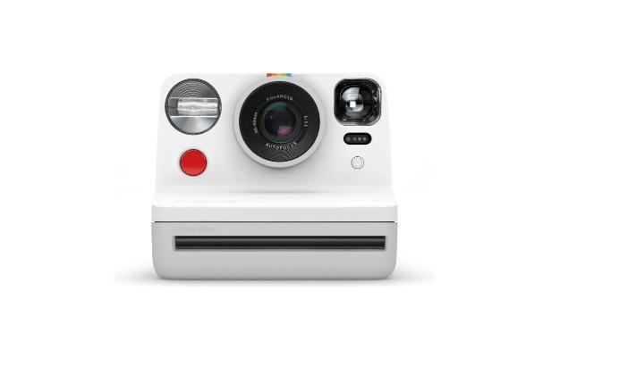 A white Polaroid camera