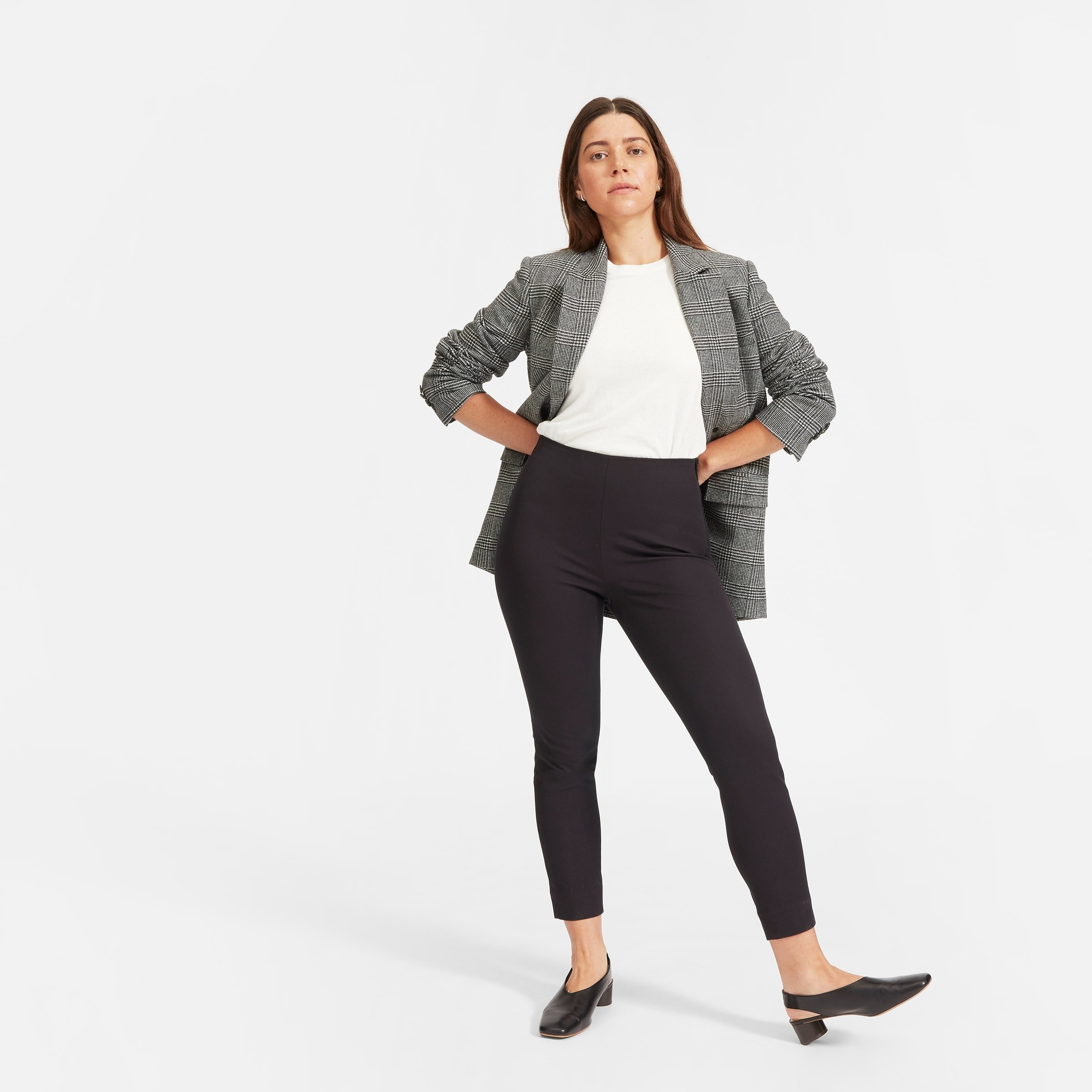 Model in the ankle length black pants
