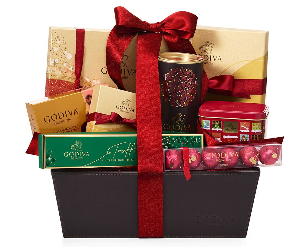 basket filled with various Godiva chocolate goodies