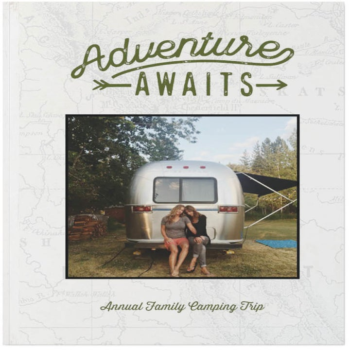 "a book labeled ""adventure awaits"""