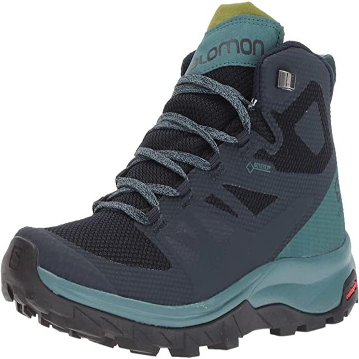 Side view of the teal-colored boot