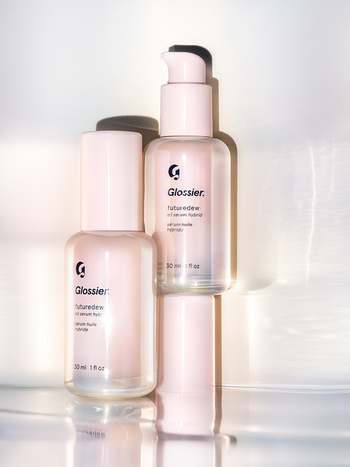 Pink and clear bottles of Glossier's Futuredew hybrid serum