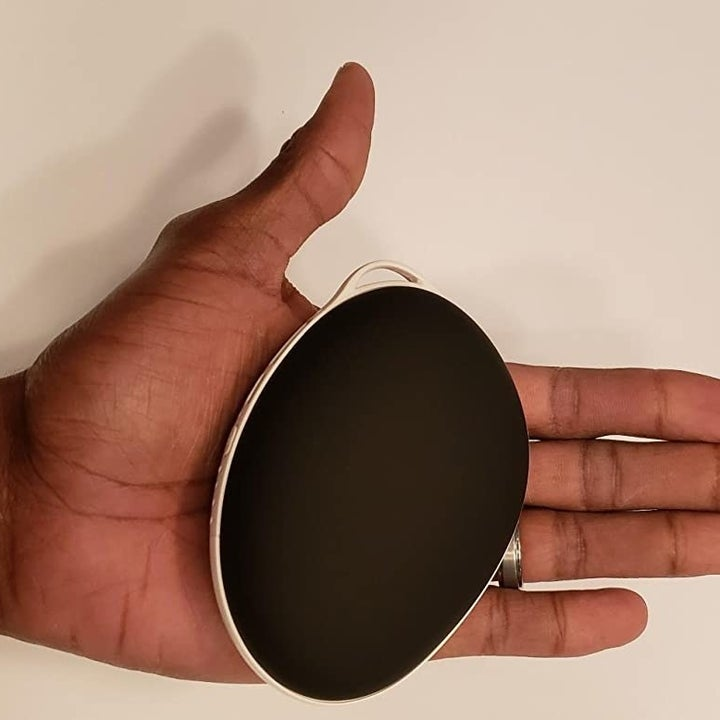 Reviewer holding the handwarmer