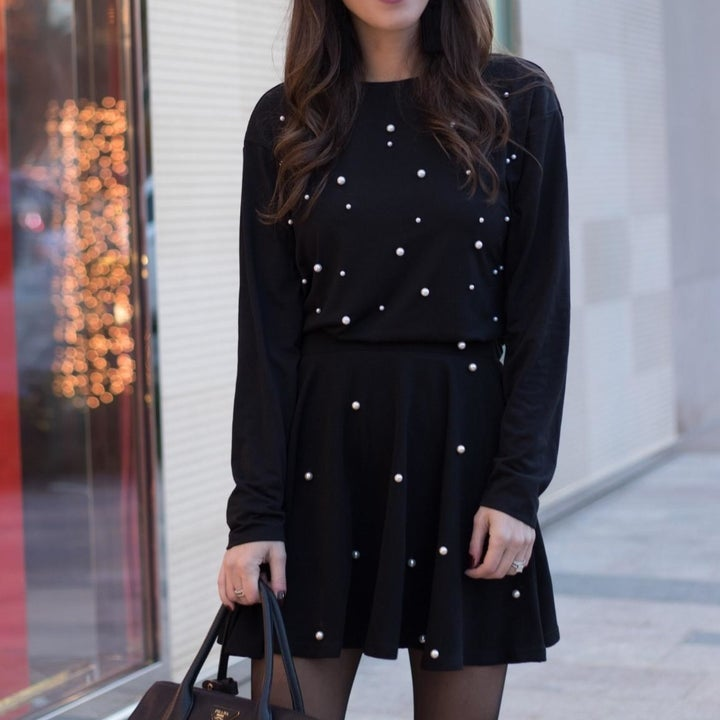 black sweatshirt with pearls all over chest