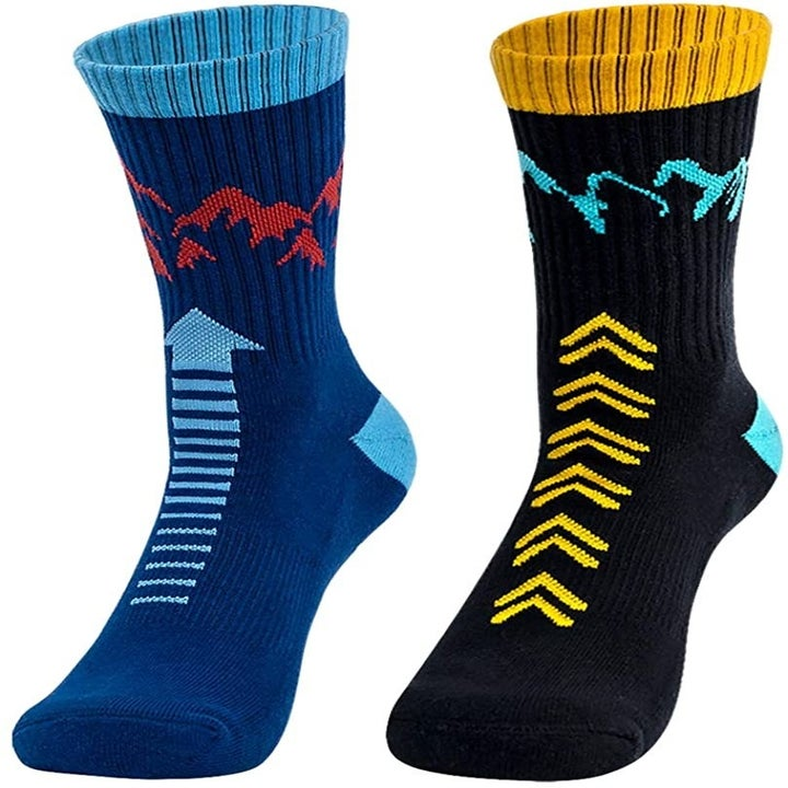 The two pack of socks showing the black and yellow pair with teal blue mountain design