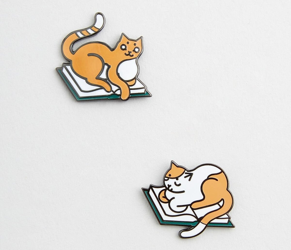 cats on top of books pins