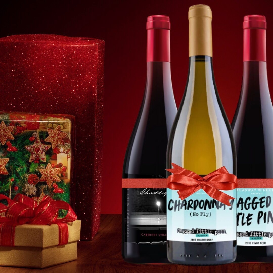 Three bottles of wine with bows on them and specific Broadway-themed labels