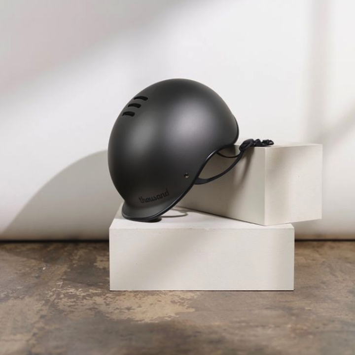 A close-up of a black bike helmet