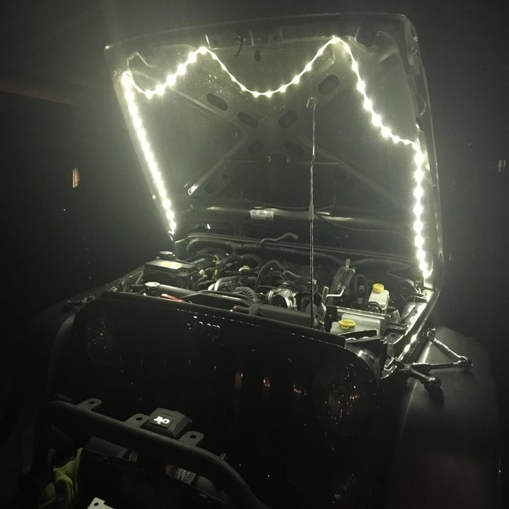 Reviewer with Luminoodle lights attached to the hood of their car