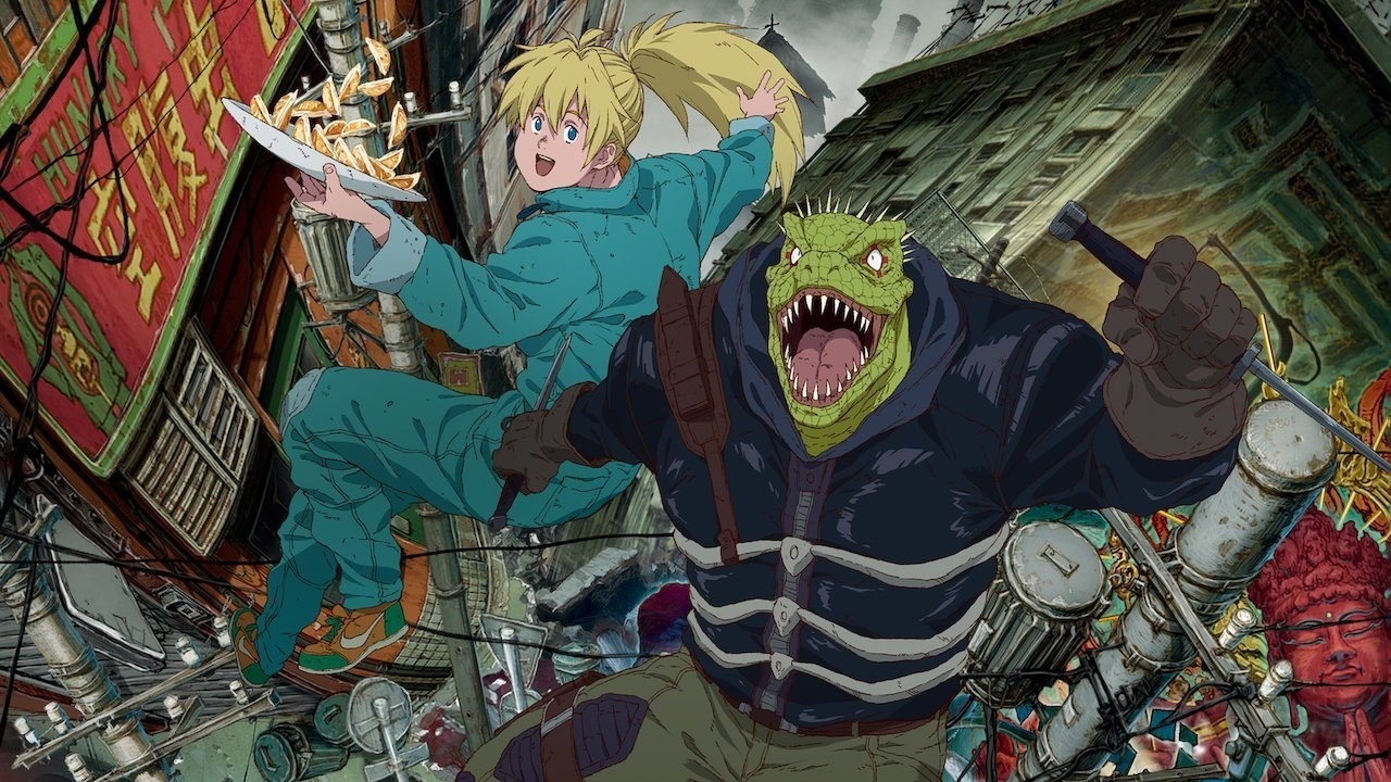 Kaiman and Nikaido are back-to-back while jumping mid-air; the city is beneath them