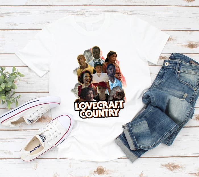 the graphic shirt with the characters of the show Lovecraft Country printed on it