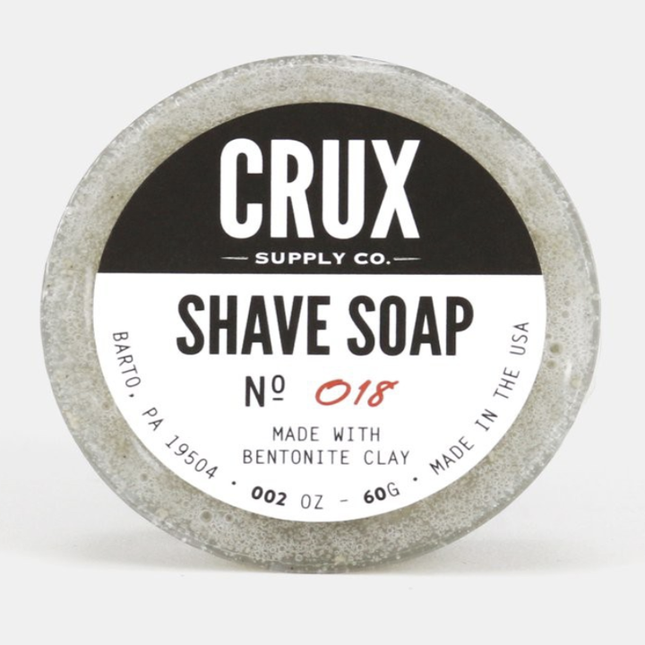 A close-up of the Crux shave soap packaging