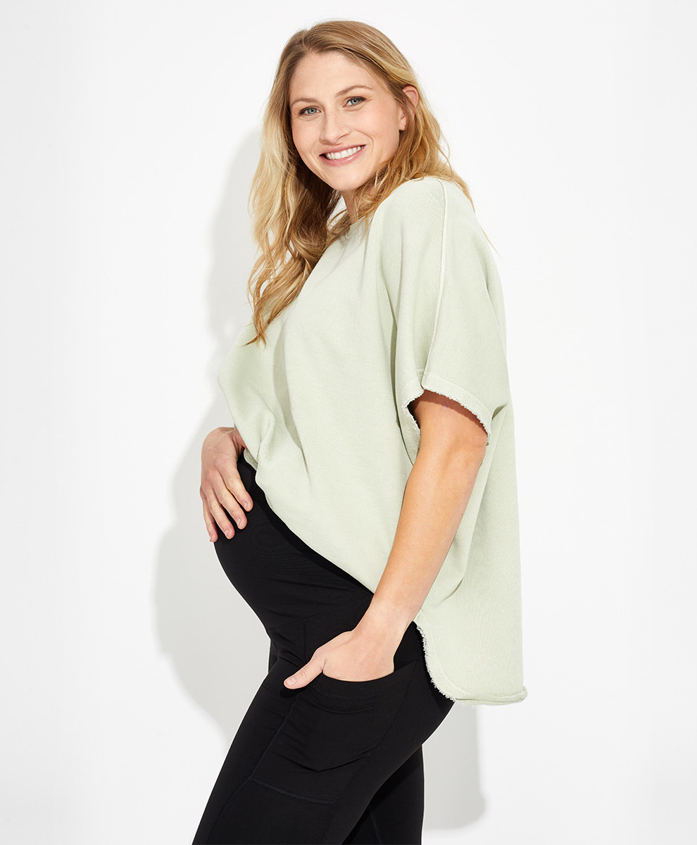 a model wearing black maternity leggings